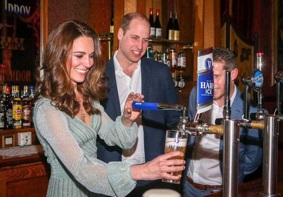 <p>Kate pulled pints of lager while Will watched dotingly at the Empire Music Hall on a visit to Belfast, Northern Ireland . </p>