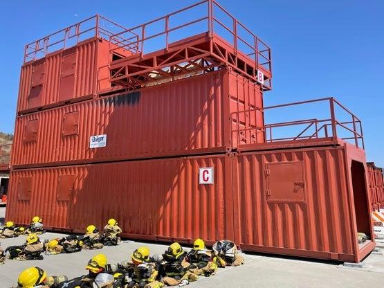 Firefighters training in San Diego use shipping containers to mimic burning buildings (Louise Boyle)