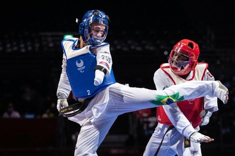 Taekwondo is one of two sports making their debut in Tokyo, along with badminton (AFP/Philip FONG)