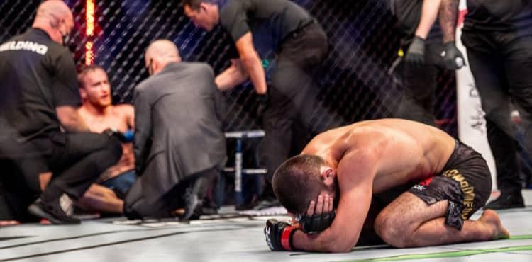 Khabib kneels and cries after beating Justin Gaethje at UFC 254