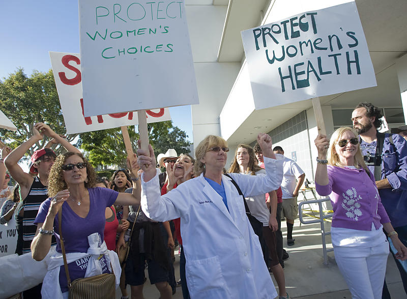 "Pro-Choice and Anti-Abortion groups faced off at a rally outside Hoag's Hospital in Newport Beach Thursday June 20, 2013. The Pro-Choice group is protesting Hoag's Hospital decision to stop all ""direct"" abortions. (AP Photo/Orange County Register, Rose Palmisano)"