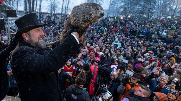 PHOTO: Groundhog Club co-handler Al Dereume holds Punxsutawney Phil, the weather prognosticating groundhog, during the 134th celebration of Groundhog Day on Gobbler's Knob in Punxsutawney, Pa. Sunday, Feb. 2, 2020. (Barry Reeger/AP)