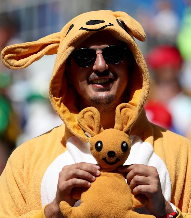 <p>Here's looking at 'roo: An Australia fan makes it clear where he's from before their match against France. (Rex) </p>