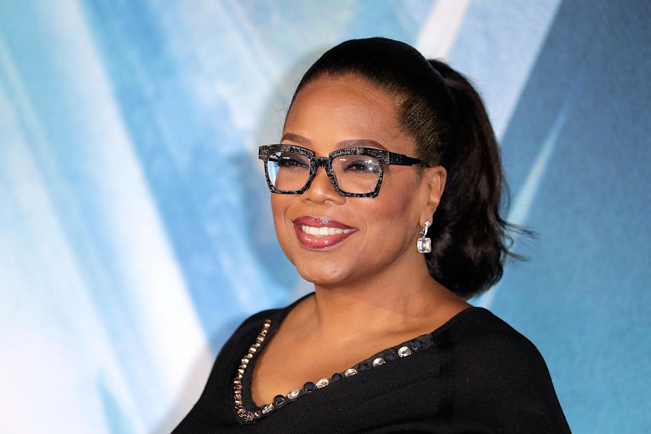 <p>Oprah Winfrey is confirmed to be attending the wedding and wearing a Philip Treacy hat.<br /> [Photo: Getty] </p>