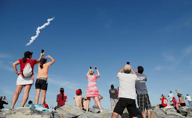 <p>Spectators at Cocoa Beach watch SpaceX's first Falcon Heavy rocket launch from the Kennedy Space Center, Fla., Feb, 6, 2018. (Photo: Gregg Newton/Reuters) </p>