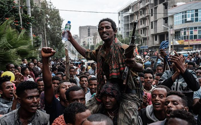 A soldier of Tigray Defence Force (TDF) is escorted by people on a street as he returns in Mekele, the capital of Tigray region, Ethiopia - afp/afp