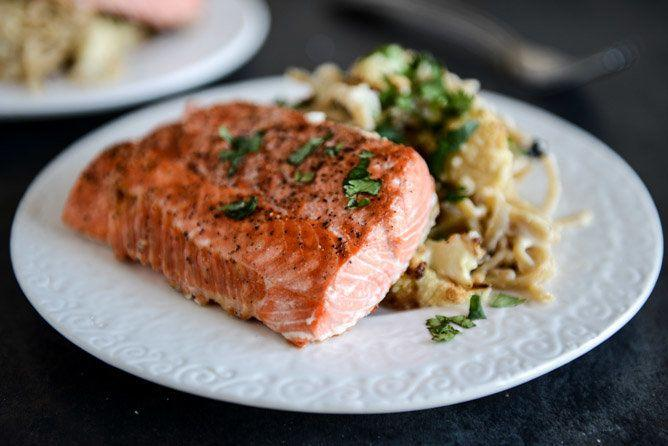 """<strong>Get the <a href=""""http://www.howsweeteats.com/2013/02/broiled-salmon-and-roasted-garlic-cream-noodles-with-crispy-cauliflower-toasted-pine-nuts/"""" target=""""_blank"""">Broiled Salmon and Roasted Garlic Cream Noodles recipe</a> from How Sweet It Is</strong>"""