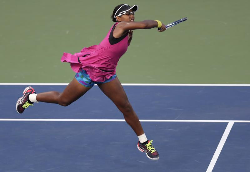 Victoria Duval, of the United States, returns against Samantha Stosur, of Australia, in the first round of the 2013 U.S. Open tennis tournament, Tuesday, Aug. 27, 2013, in New York. Duval won 5-7, 6-4, 6-4. (AP Photo/Charles Krupa)