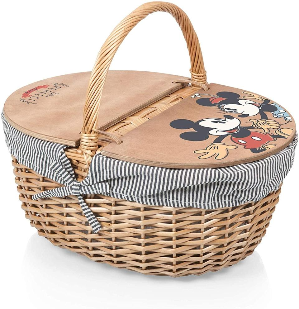 <p>Treat yourself to a romantic picnic outdoors with this classic <span>Picnic Time Disney Classics Mickey and Minnie Mouse Country Basket with Liner</span> ($106). You'll be living out your Disney dreams!</p>