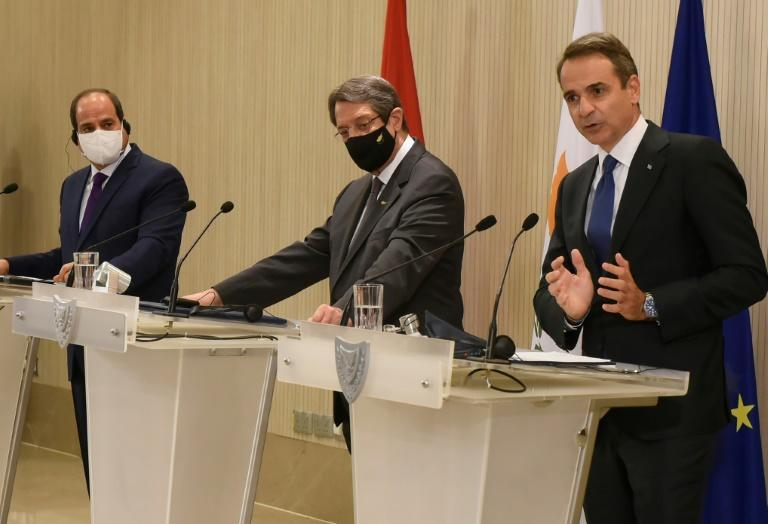 Cypriot President Nicos Anastasiades (C) and Egyptian President Abdel Fattah al-Sisi (L) watch on as Greek Prime Minister Kyriakos Mitsotakis speaks at a joint news conference in Nicosia on October 21, 2020