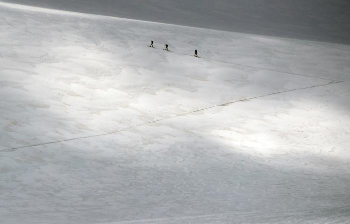 A group of scientists from the Austrian Institute for Interdisciplinary Mountain Research cross the Jamtalferner glacier near Galtuer, Austria. (Photo: Lisi Niesner/Reuters)