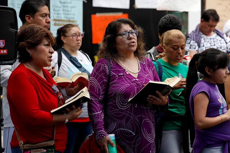 Rosalba Ramirez Vargas, center, with the prayer group 'The Best Friends of Jesus' pray while anxiously waiting for news from rescue crews at Enrique Rebsamen School in Mexico City.