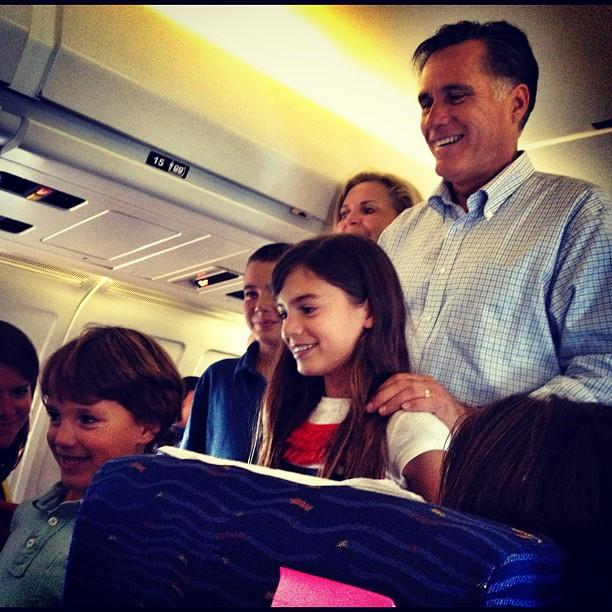 Mitt Romney and his grandkids on his plan en route to Wisconsin Sunday night. (Holly Bailey/Yahoo News)