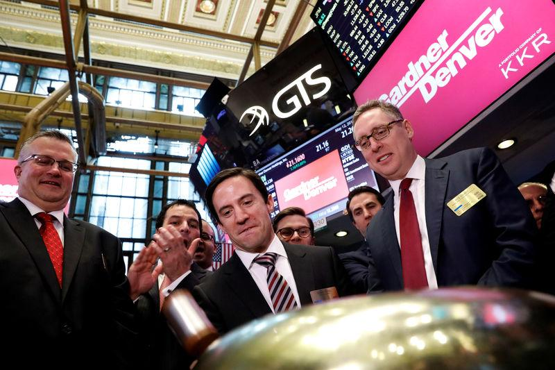 Vicente Reynal, CEO of Gardner Denver, rings a ceremonial bell to celebrate his company's IPO on the floor of the NYSE in New York