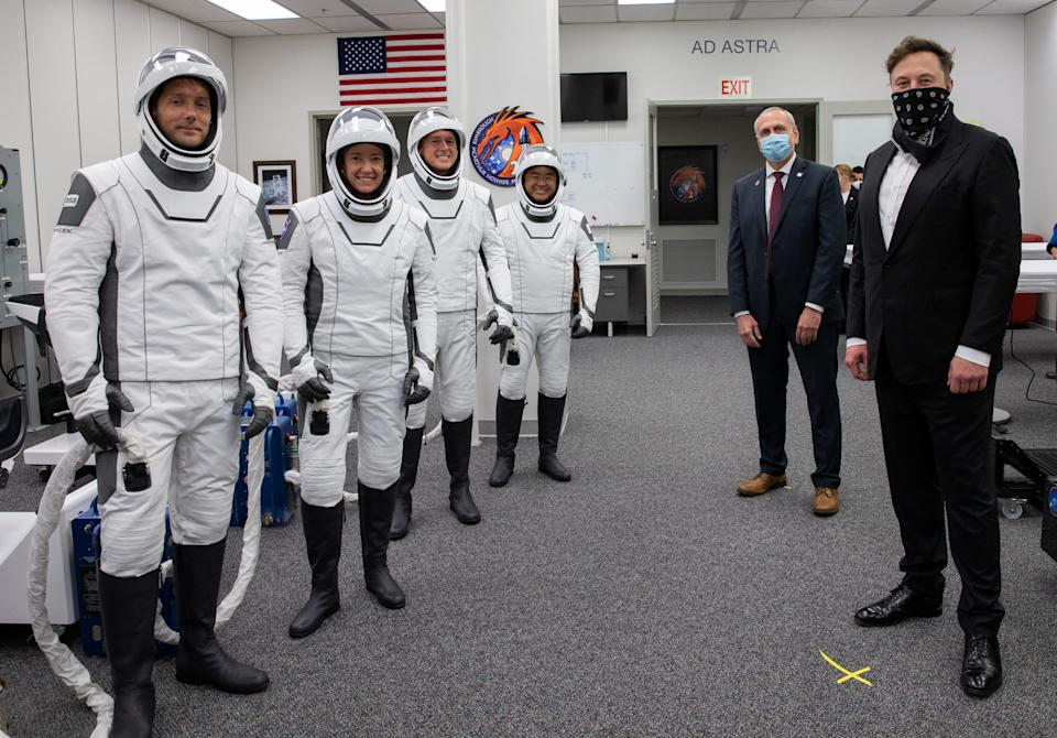 SpaceX CEO and founder Elon Musk and NASA acting administrator Steve Jurczyk visit with Crew-2, ESA astronaut Thomas Pesquet of France, NASA astronaut Megan McArthur, NASA astronaut Shane Kimbrough and JAXA astronaut Akihiko Hoshide of Japan inside the crew suit-up room, before the boarding of the SpaceX Falcon 9 rocket with the Crew Dragon capsule bound for the International Space Station in Cape Canaveral, Florida, U.S., April 23, 2021. Picture taken April 23, 2021.  NASA/Kim Shiflett/Handout via REUTERS.   MANDATORY CREDIT. THIS IMAGE HAS BEEN SUPPLIED BY A THIRD PARTY.