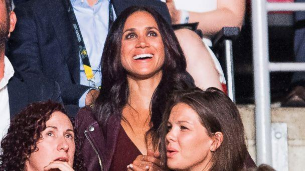 Meghan Markle, top, attends the Invictus Games Opening Ceremonies in Toronto on Saturday, Sept. 23, 2017, a few rows apart from her boyfriend, Britain's Prince Harry. Markle lives in Toronto, but hadn't appeared with Harry since he arrived in the city. (Nathan Denette/The Canadian Press via AP)