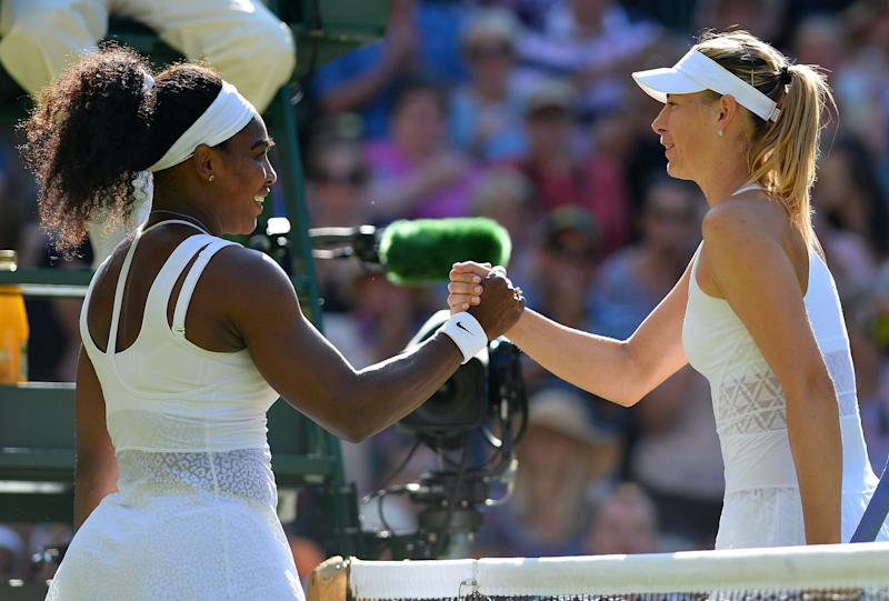 US player Serena Williams (L) shakes hands with Russia's Maria Sharapova (R) after Williams won their women's semi-final match on day ten of the 2015 Wimbledon Championships at The All England Tennis Club in Wimbledon, southwest London, on July 9, 2015. Williams won 6-2, 6-4. RESTRICTED TO EDITORIAL USE -- AFP PHOTO / GLYN KIRK (Photo credit should read GLYN KIRK/AFP/Getty Images)