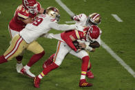 San Francisco 49ers' DeForest Buckner (99) and Earl Mitchell sack Kansas City Chiefs quarterback Patrick Mahomes (15), during the first half of the NFL Super Bowl 54 football game, Sunday, Feb. 2, 2020, in Miami Gardens, Fla. Kansas City Chiefs' Laurent Duvernay-Tardif (76), left, attempts to defend. (AP Photo/Charlie Riedel)