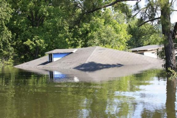 Last month also brought heavy precipitation to parts of the U.S. The only part of this home in Vicksburg Mississippi above water on May 13, 2011 was the roof.