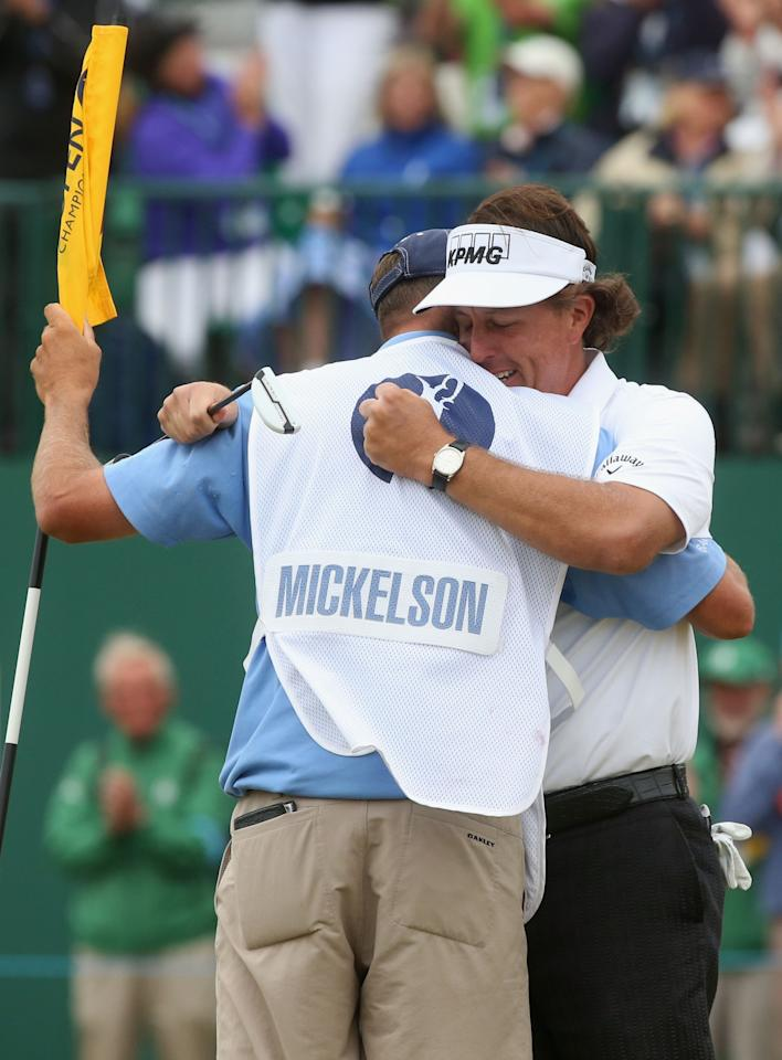 GULLANE, SCOTLAND - JULY 21: Phil Mickelson of the United States hugs his caddie Jim Mackay after completing his final round of the 142nd Open Championship at Muirfield on July 21, 2013 in Gullane, Scotland. (Photo by Andrew Redington/Getty Images)