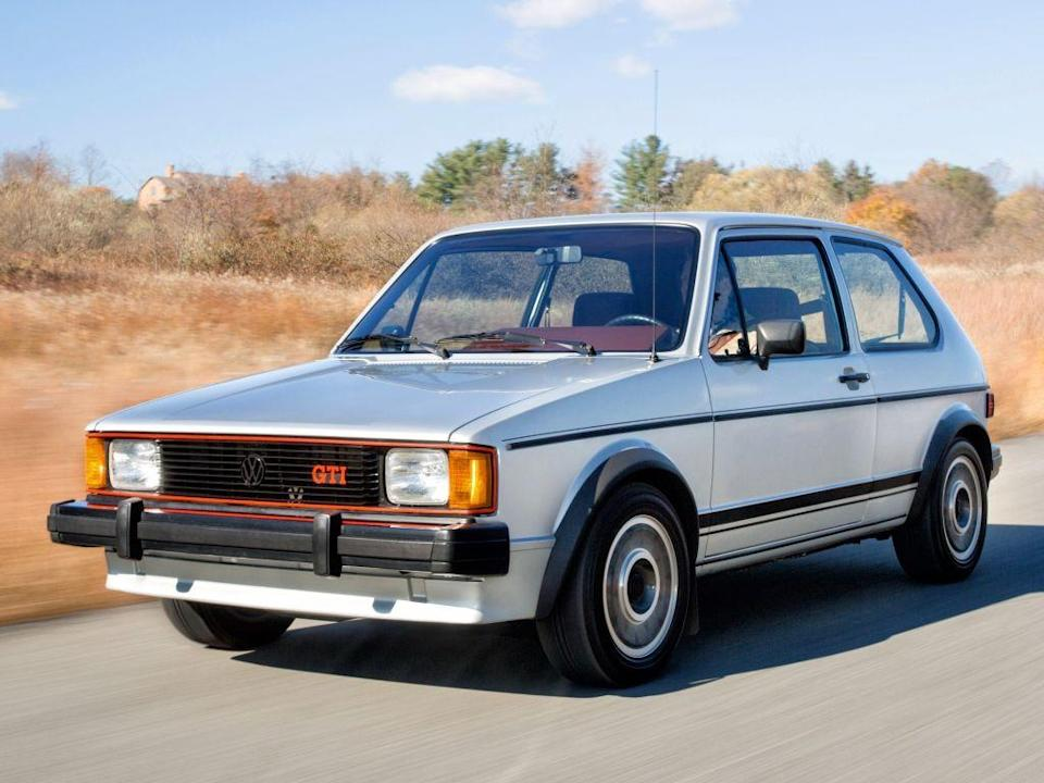 """<p>While the rest of the world basked in the original Golf GTI's glow, the U.S. was given a version based on the unloved Rabbit that was built in Westmoreland, Pennsylvania. In spite of the general terribleness emitted by that factory and the mandatory U.S.-market emissions equipment that sapped horsepower relative to the Euro model, the Rabbit GTI was fun to drive and set the table for <a href=""""https://www.caranddriver.com/features/g18665243/volkswagen-gti-the-history-of-an-icon/"""" rel=""""nofollow noopener"""" target=""""_blank"""" data-ylk=""""slk:a long history of GTI models"""" class=""""link rapid-noclick-resp"""">a long history of GTI models</a>. And is there anything more '80s than a white-painted hatchback?<em>—Alexander Stoklosa</em></p>"""