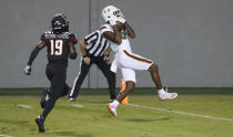 Miami wide receiver Dee Wiggins (8) pulls in a 39-yard touchdown reception as North Carolina State defensive back Joshua Pierre-Louis (19) trails during the first half of an NCAA college football game Friday, Nov. 6, 2020, in Raleigh, N.C. (Ethan Hyman/The News & Observer via AP, Pool)