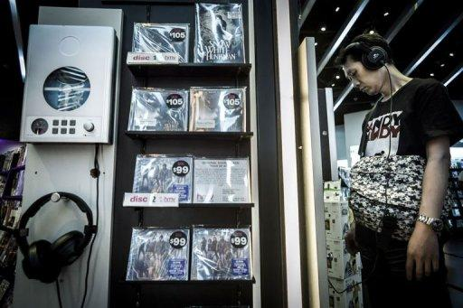 A customer listens to a CD in a music shop in Hong Kong. China has seen an estimated 99% digital piracy rate in recent years, meaning the legitimate market has operated at only a fraction of its true potential, according to the IFPI