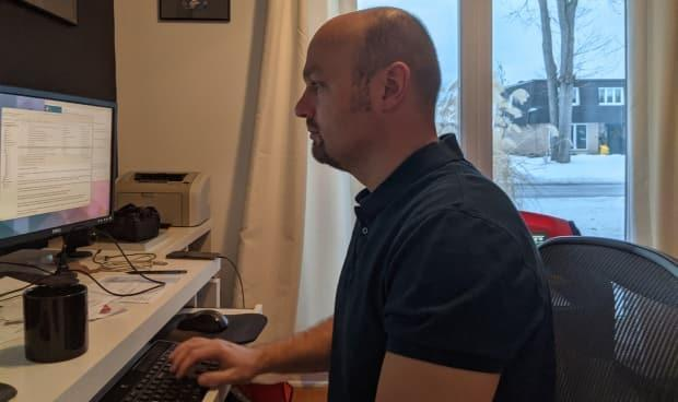 Software designer Pat Suwalski is seen working from his desk at home in Nepean, Ont.