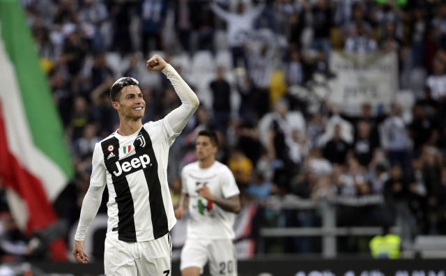 Juventus' Cristiano Ronaldo celebrates at the end of a Serie A soccer match between Juventus and AC Fiorentina, at the Allianz stadium in Turin, Italy, Saturday, April 20, 2019. Juventus clinched a record-extending eighth successive Serie A title, with five matches to spare, after it defeated Fiorentina 2-1. (AP Photo/Luca Bruno)
