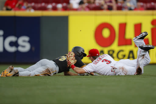 Cincinnati Reds second baseman Scooter Gennett (3) catches Pittsburgh Pirates' Adam Frazier, left, stealing in the first inning of a baseball game, Monday, July 29, 2019, in Cincinnati. (AP Photo/John Minchillo)