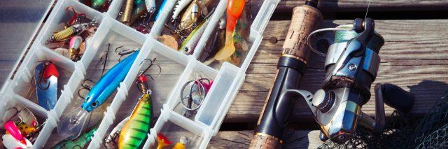 A fishing pool and a tackle box on a pier.