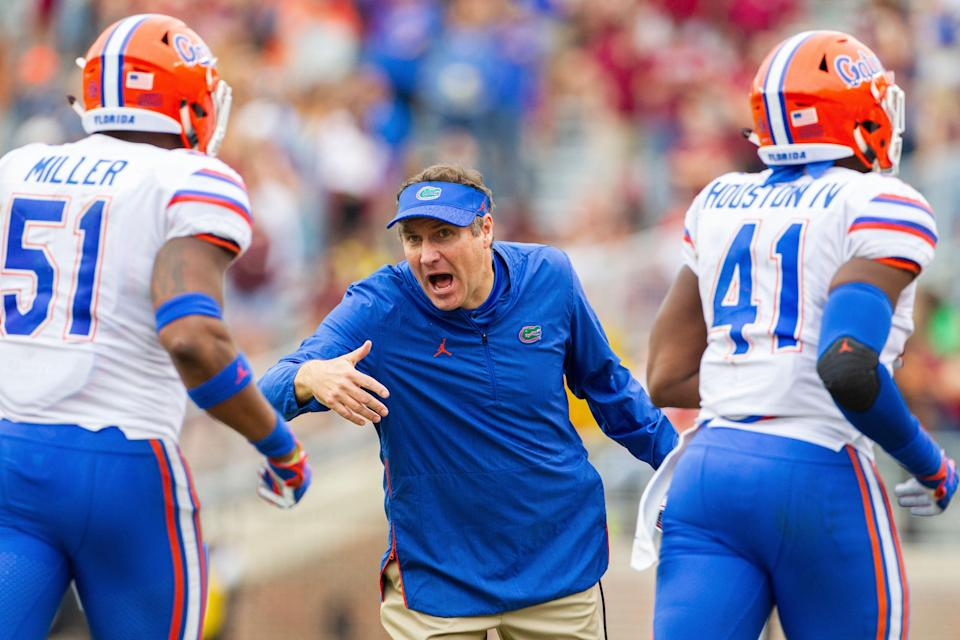Florida Gators head coach Dan Mullen rushes his team off the field in the 2nd half of an NCAA college football game against Florida State in Tallahassee, Fla., Saturday, Nov. 24, 2018. Florida defeated Florida State 41-14. (AP Photo/Mark Wallheiser)