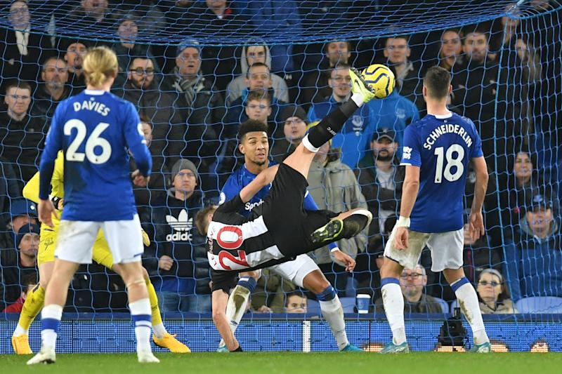 Newcastle's Florian Lejeune (20) scores the first of his two goals against Everton on Tuesday. (Photo by PAUL ELLIS/AFP via Getty Images)