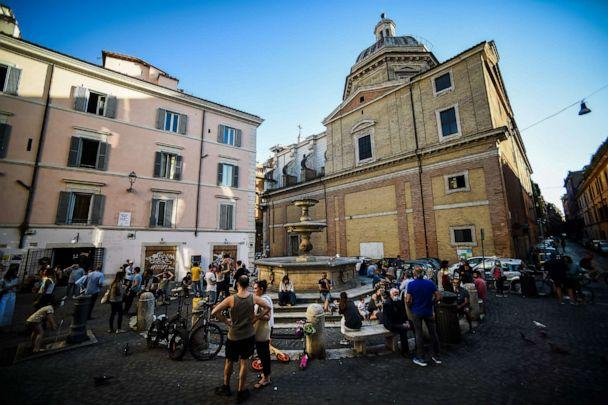 PHOTO: People share a neighborhood outdoors aperitif drink at a square in Rome on May 21, 2020. (Filippo Monteforte/AFP via Getty Images)