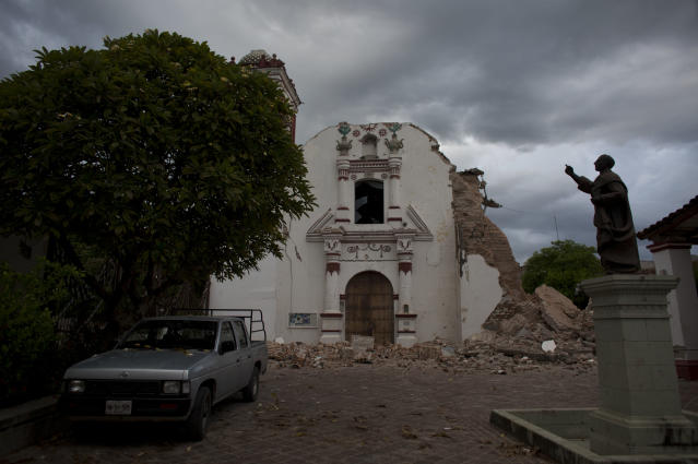 <p>San Vicente church stands heavily damaged after Thursday's magnitude 8.1 earthquake, in Juchitan, Oaxaca state, Mexico, Sunday, Sept. 10, 2017. In the quake-shocked city of Juchitan, a third of the homes are reported uninhabitable and repeated aftershocks have scared people away from many structures still standing. (AP Photo/Rebecca Blackwell) </p>