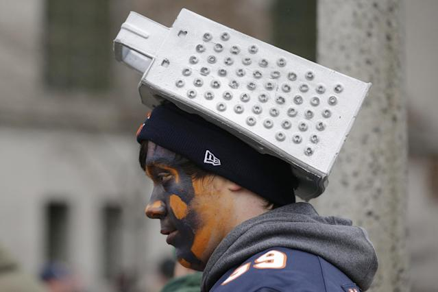 A Chicago Bears fan fashions a cheese grater on his head before an NFL football game between the Bears and Green Bay Packers, Sunday, Dec. 29, 2013, in Chicago. (AP Photo/Nam Y. Huh)