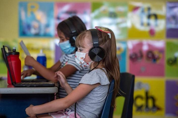Students are masked up while they do lessons on their computers in a first grade summer school classroom at Phillis Wheatley Elementary School in Kansas City. With the start of the school year a month away, Kansas City area districts are deciding on masks and vaccine rules as COVID-19 cases surge.