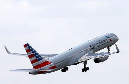 An American Airlines Boeing 757 aircraft takes off at the Charles de Gaulle airport in Roissy