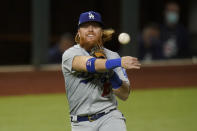 Los Angeles Dodgers third baseman Justin Turner throws out Atlanta Braves' Travis d'Arnaud out at first during the second inning in Game 4 of a baseball National League Championship Series Thursday, Oct. 15, 2020, in Arlington, Texas. (AP Photo/Eric Gay)