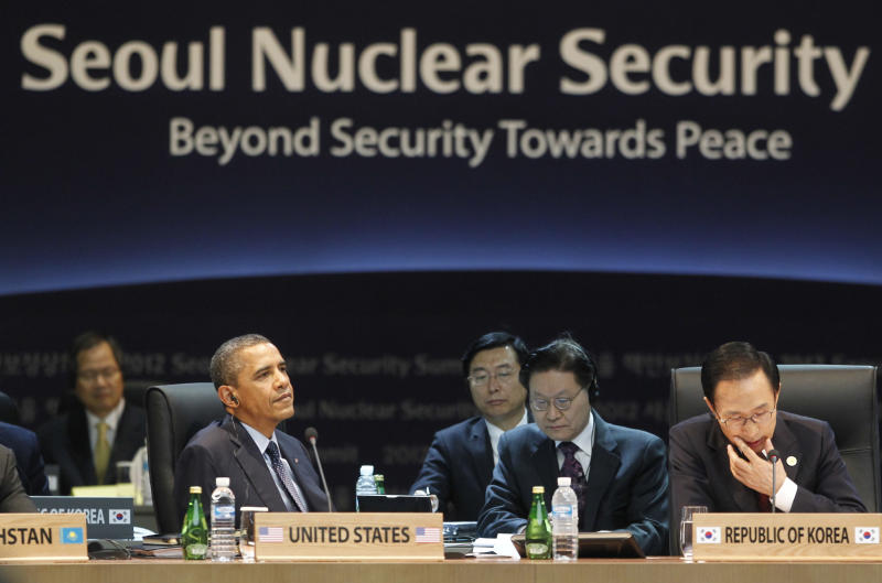 U.S. President Barack Obama and South Korean President Lee Myung-bak attend the opening plenary session at the Nuclear Security Summit at the Coex Center, in Seoul, South Korea, Tuesday, March 27, 2012. Sitting in the center is South Korean President Lee Myung-bak. (AP Photo/Pablo Martinez Monsivais)