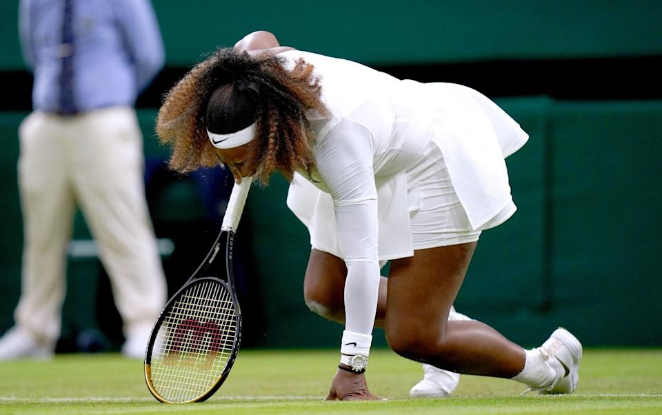 Serena Williams goes down injured during her first round ladies' singles match against Aliaksandra Sasnovich on centre court on day two of Wimbledon at The All England Lawn Tennis and Croquet Club, - PA