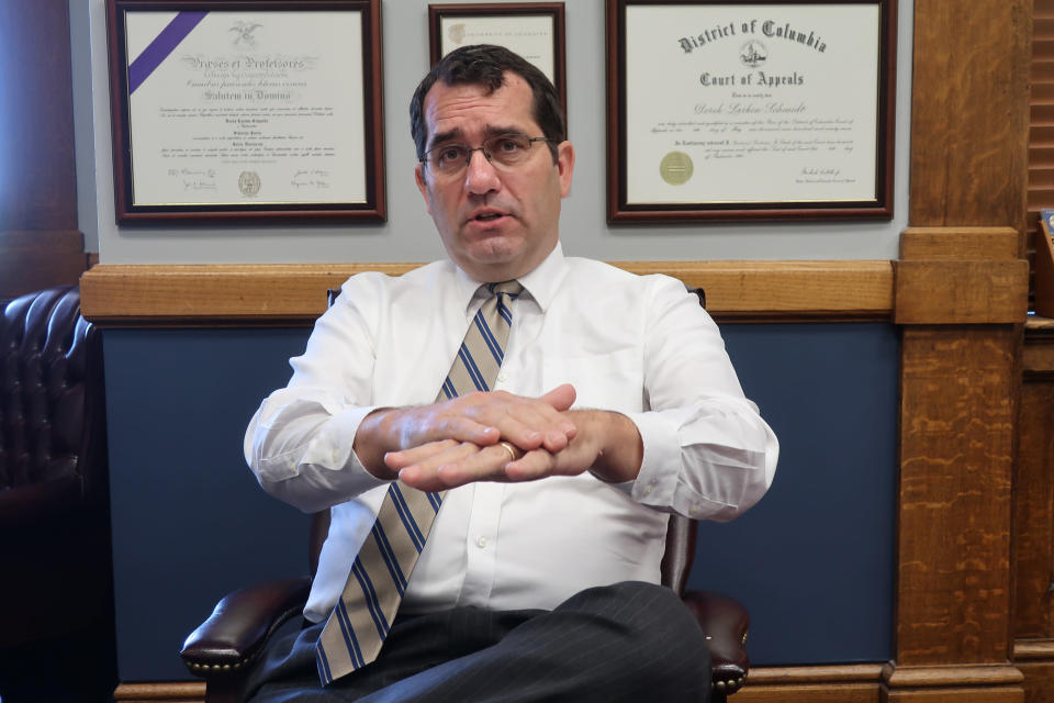 FILE - In this Thursday, July 23, 2020 file photo, Kansas Attorney General Derek Schmidt speaks during an interview in his office in Topeka, Kan. Schmidt, first elected in 2010, is running for Kansas governor in 2022. (AP Photo/John Hanna, File)