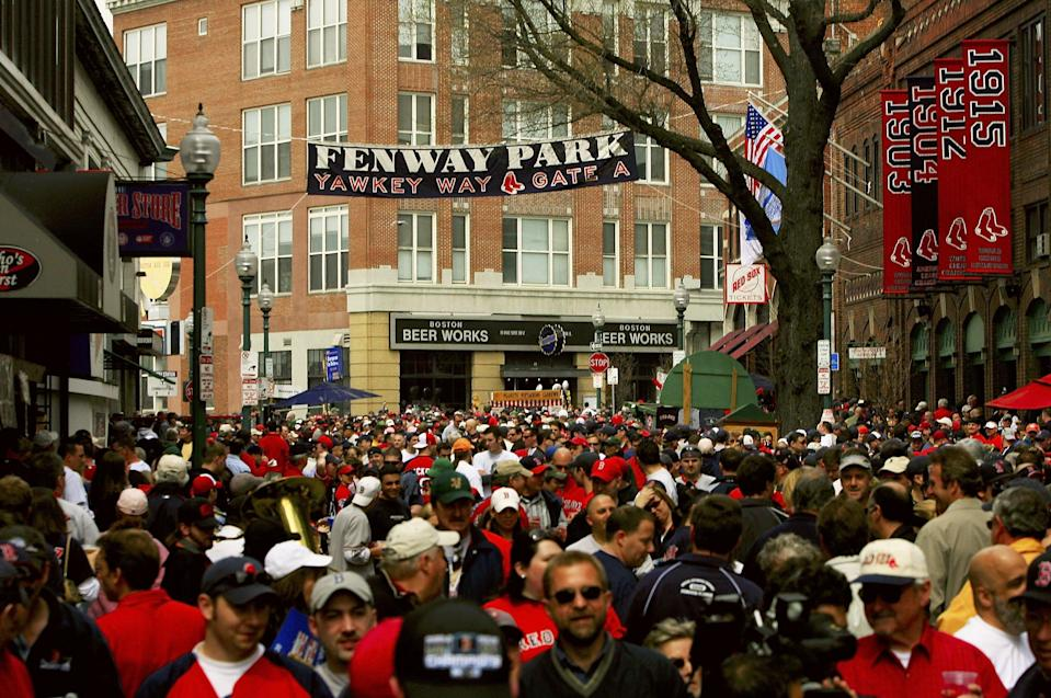 Fans line Yawkey Way before every Red Sox game at Fenway Park. (Getty)