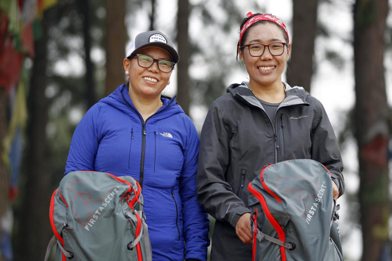 In this photo taken Saturday, March 30, 2019, Nima Doma, 34, right, and Furdiki Sherpa, 43, stand for photographs after their morning exercise as they train to summit Mount Everest, in Kathmandu, Nepal. Five years after one of the deadliest disasters on Mount Everest, three people from Nepal's ethnic Sherpa community, including Doma and Sherpa, are preparing an ascent to raise awareness about the Nepalese mountain guides who make it possible for hundreds of foreign climbers to scale the mountain and survive. The two women lost their husbands in the 2014 ice avalanche on Everest's western shoulder that killed 16 fellow Sherpa guides. (AP Photo/Niranjan Shrestha)