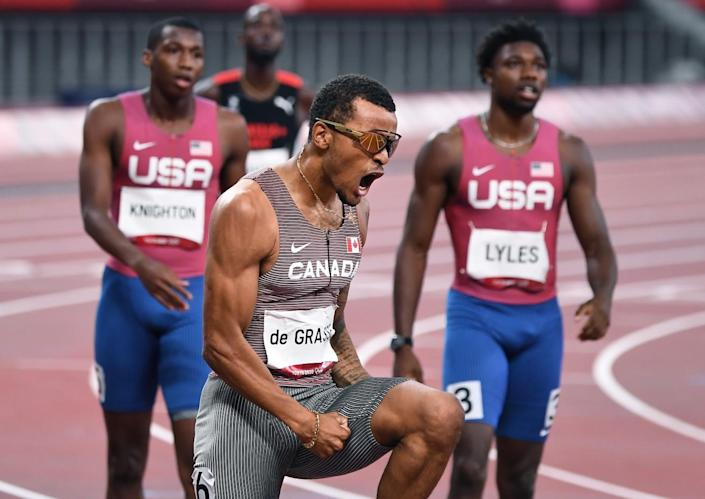 Canada's Andre de Grasse celebrates the gold medal in the 200m final.
