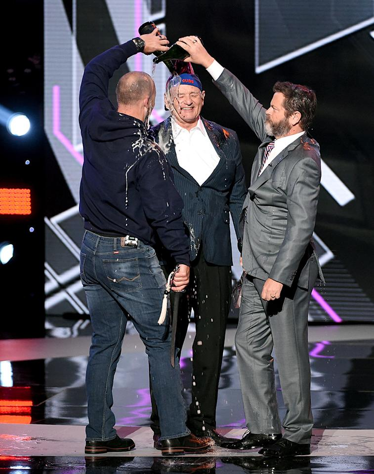 <p>Bill Murray continues to celebrate the win of World Series champs the Chicago Cubs. At the ESPY Awards in L.A. on July 12, the actor accepted the award for Best Moment on behalf of the team and was sprayed with Champagne by MLB's David Ross and actor Nick Offerman. (Photo: Kevin Winter/Getty Images) </p>