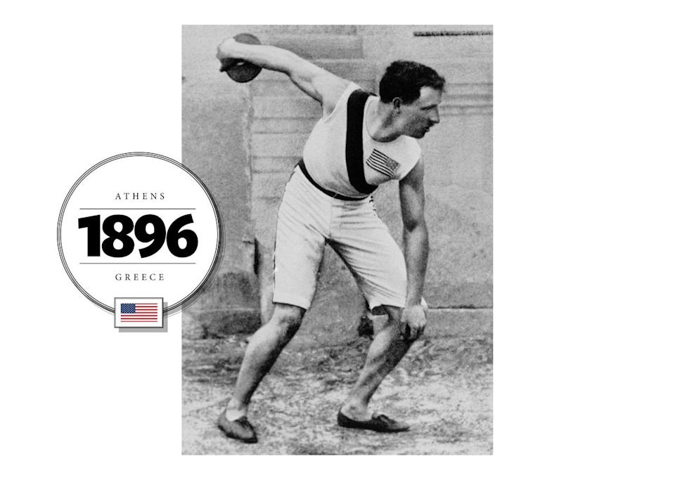 Robert Garrett, an American discus throw and shot put athlete, won gold medals for each event at the 1896 Summer Olympics. While competing, Garrett wore shorts to the knee and a tank top emblazoned with the U.S. flag (with 45 stars at the time). His shoes were a hybrid of ballerina flats and loafers. (Getty Images)