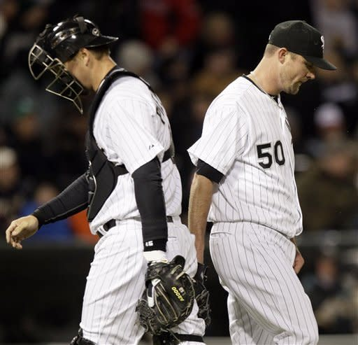 Chicago White Sox starter John Danks, right, and catcher A.J. Pierzynski look down during the sixth inning of a baseball game against the Boston Red Sox in Chicago, Friday, April 27, 2012. (AP Photo/Nam Y. Huh)
