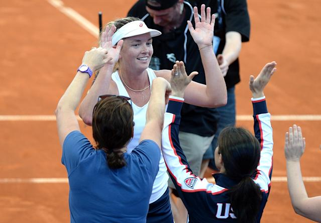 BRISBANE, AUSTRALIA - APRIL 17: Coco Vandeweghe of the USA celebrates with team captain Mary Joe Fernandez after winning her match against Samantha Stosur of Australia in the Fed Cup tie between Australia and the United States at Pat Rafter Arena on April 17, 2016 in Brisbane, Australia. (Photo by Bradley Kanaris/Getty Images)