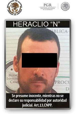 """Handout photo of a man involved in the 2010 slaying of U.S. Border Patrol agent Brian Terry, in a case tied to the government's ill-fated """"Fast and Furious"""" gun-running sting operation, distributed on April 13, 2017 by Mexico's Navy (SEMAR). The words read, """"Presumed innocent until proven guilty"""". SEMAR/Handout via REUTERS"""